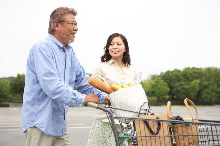 Mature Couple Pushing Shopping Cart