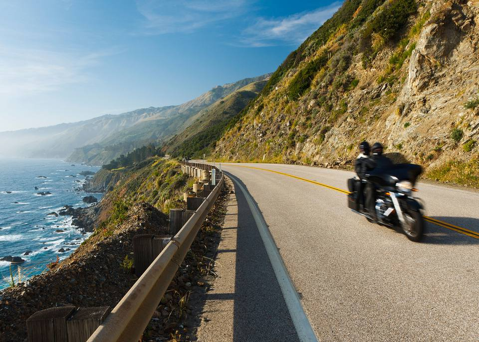 A pair on a motorcycle on the Pacific Coast Highway