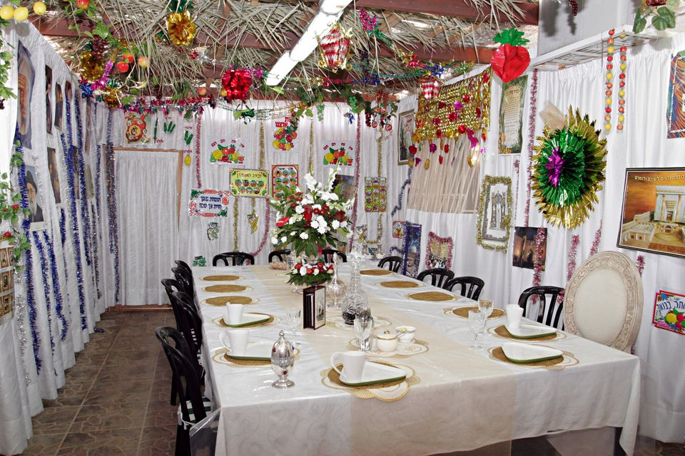 A Sukkah in Jerusalem, Israel, with a table set for a festive holiday meal.