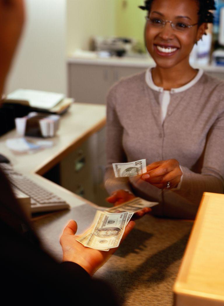 Bank Teller Giving Customer Money