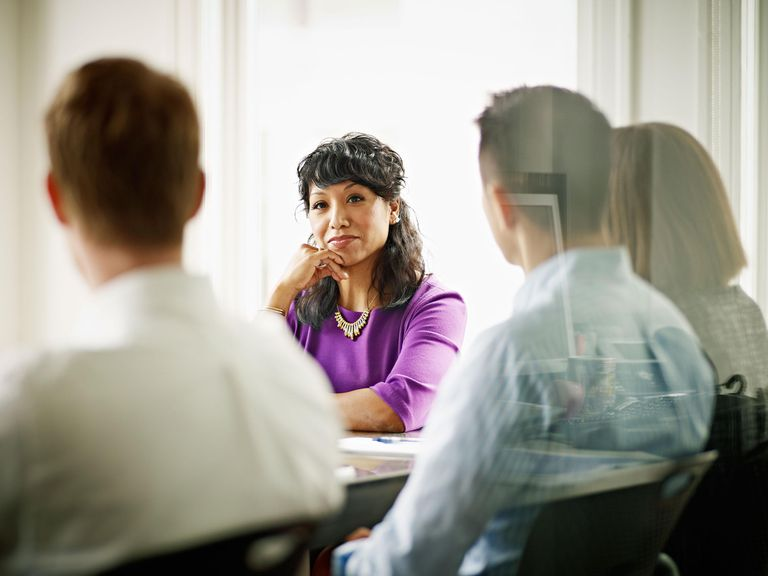 Businesswoman leading discussion with coworkers