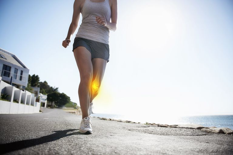 Woman running with knee joint highlighted