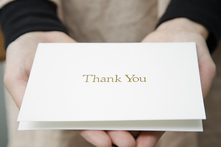 Woman Presenting Thank You Card