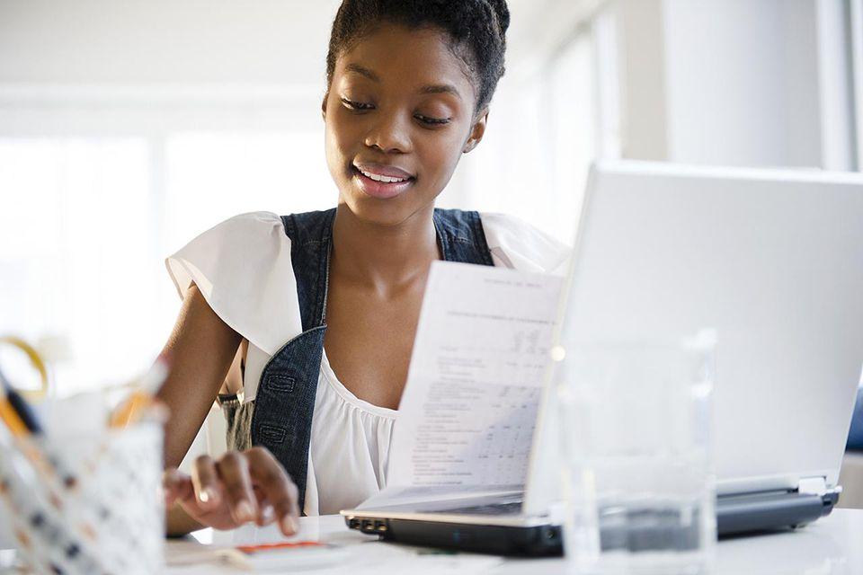Black woman paying bills online