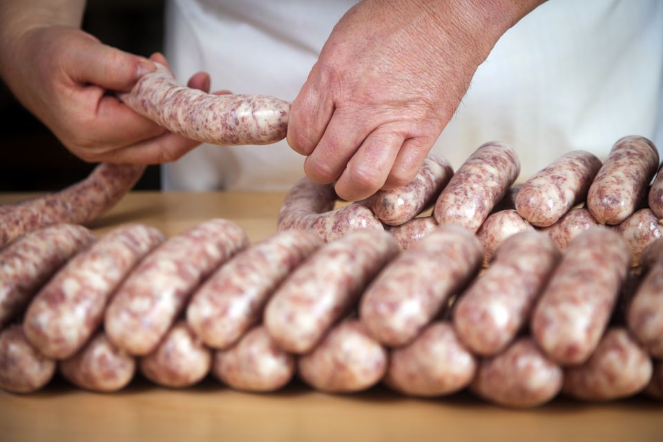A large stack of homemade sausages