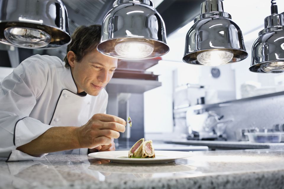 Chef putting final touches on a dish
