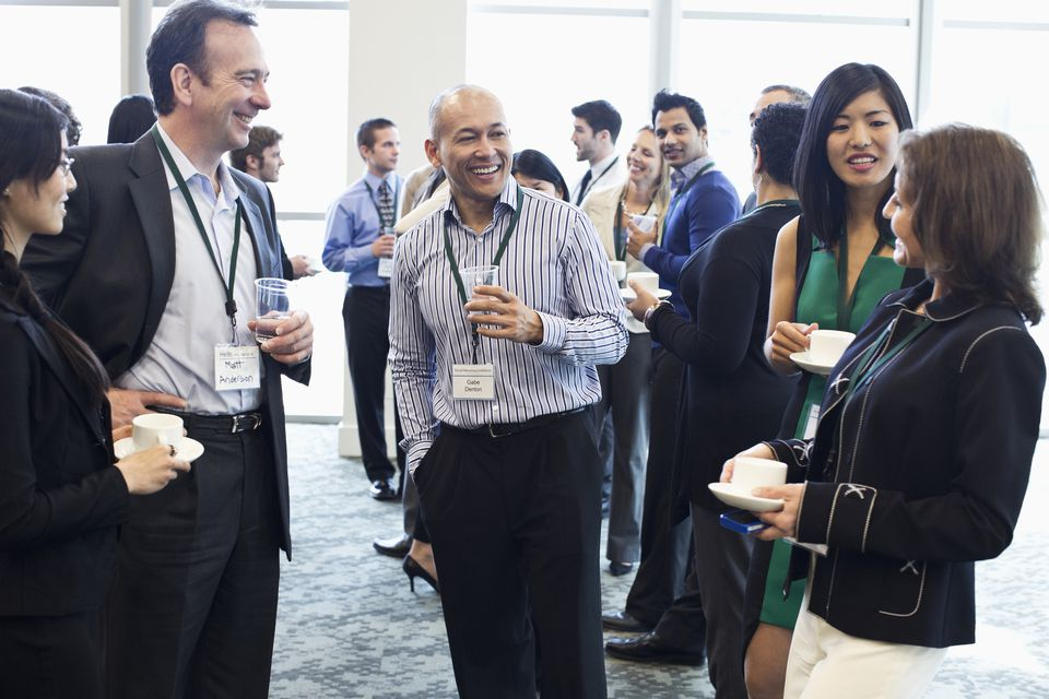 Group socializing at business conference