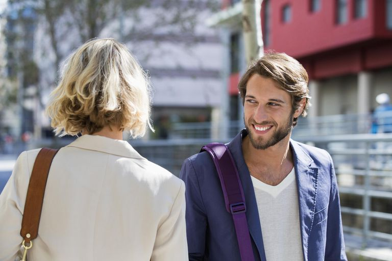 Man flirting a woman and smiling