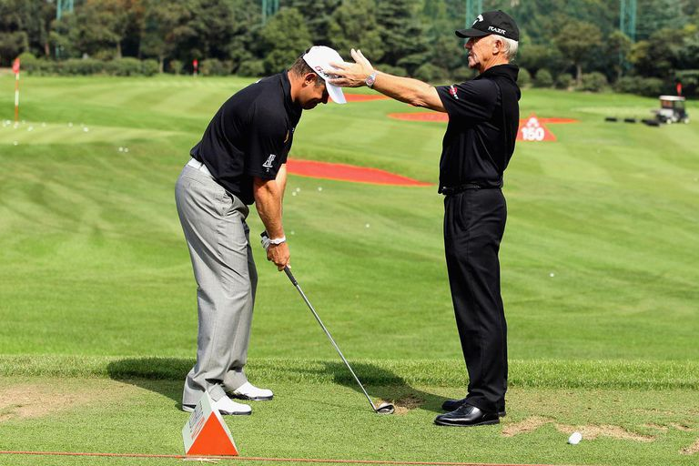 SHANGHAI, CHINA - NOVEMBER 01: Lee Westwood of England (left) is given a lesson by his coach Pete Cowen during practice prior to the start of the WGC-HSBC Champions at Sheshan International Golf Club on November 1, 2011 in Shanghai, China.