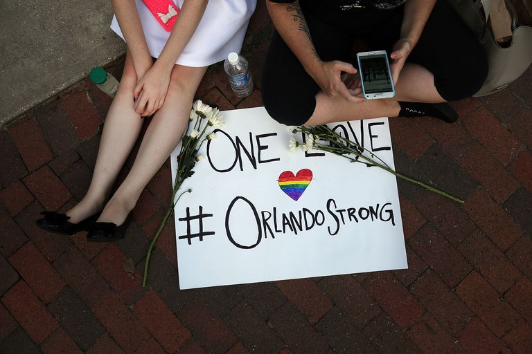 People mourning the mass shooting at Orlando gay club