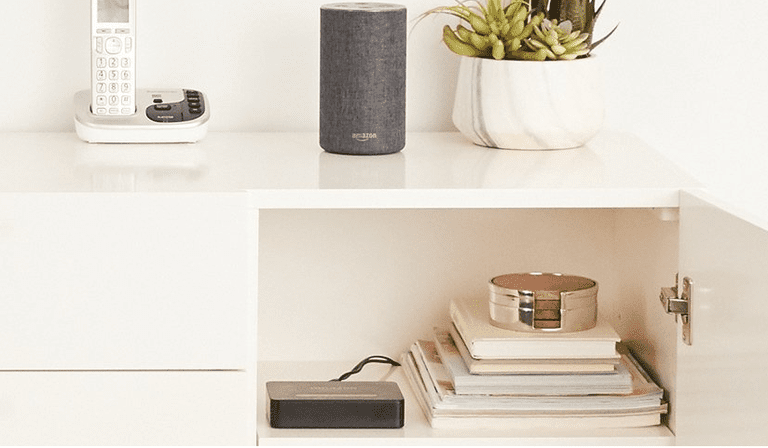 Open Cabinet Showing Amazon Echo Connect Plugged In with Home Phone and Amazon Echo on Top of Cabinet.
