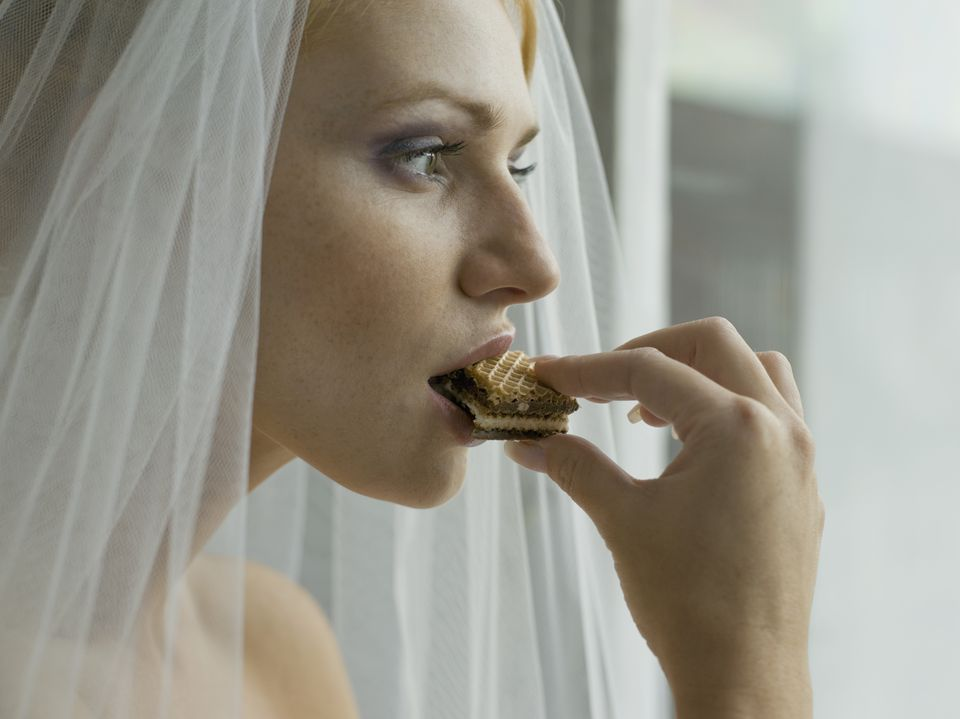 Bride eating cookie