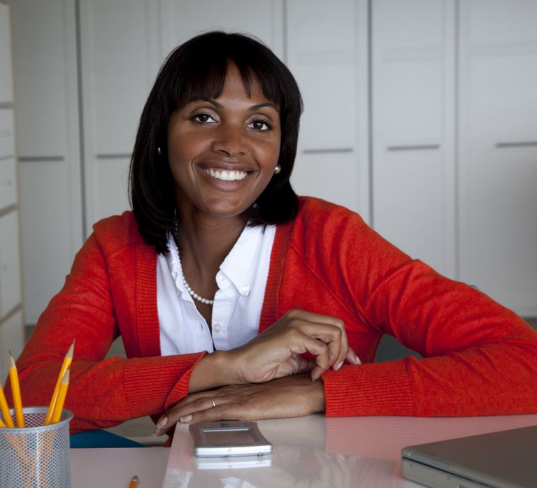 Beautiful black woman working in a red sweater