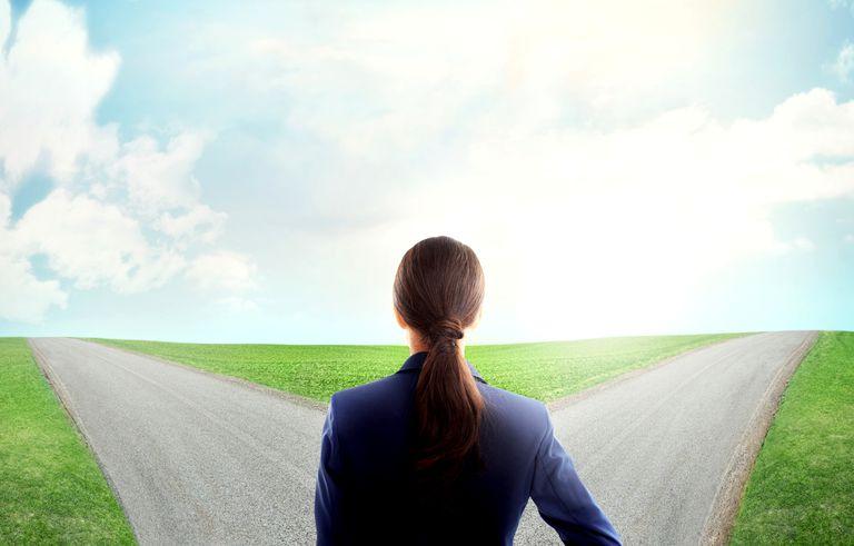 Woman facing crossroads