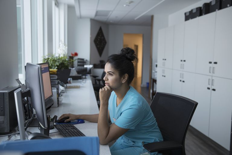 Medical office worker at a computer