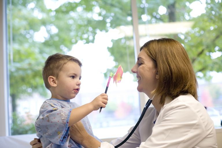 Pediatrician with little boy