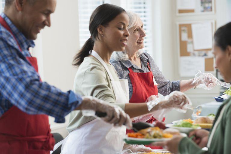 Volunteers serving food.