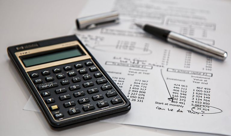 calculator and paper with financial figures