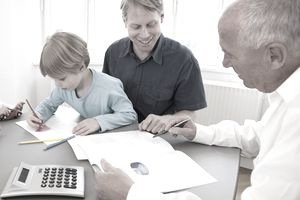 2 adult men Teaching a child about investing