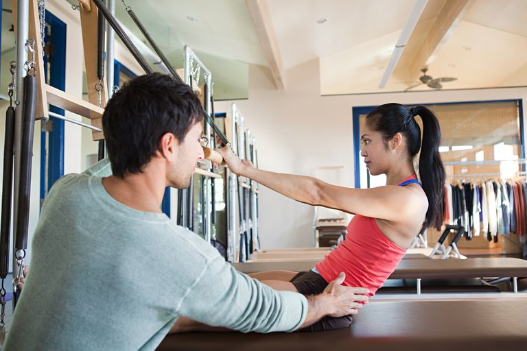 Woman having private pilates training session