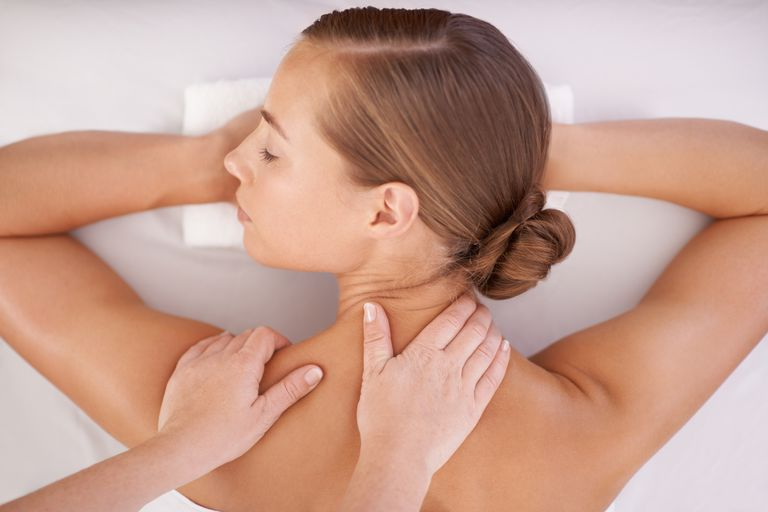 woman getting a back and neck massage