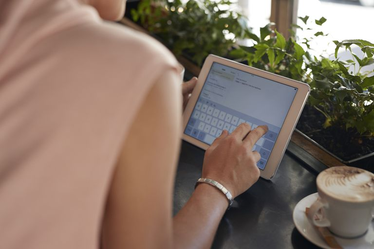 Close-up of female hands using digital tablet