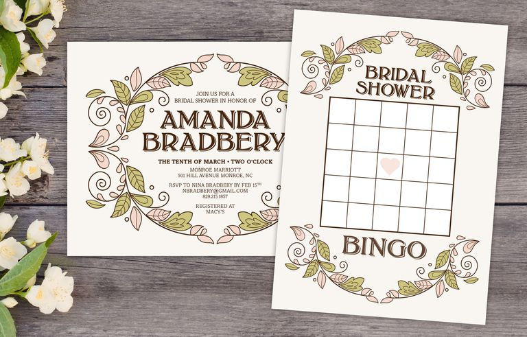 A Bridal Shower Bingo Card And Invitation On Wooden Table Surrounded By Flowers