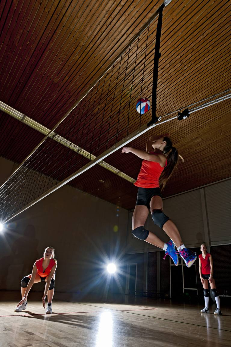 Volleyball player going for spike