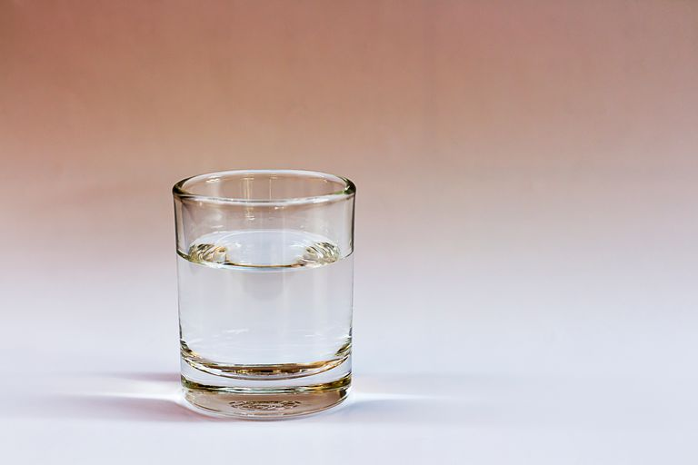 Close-up of water in glass against white background
