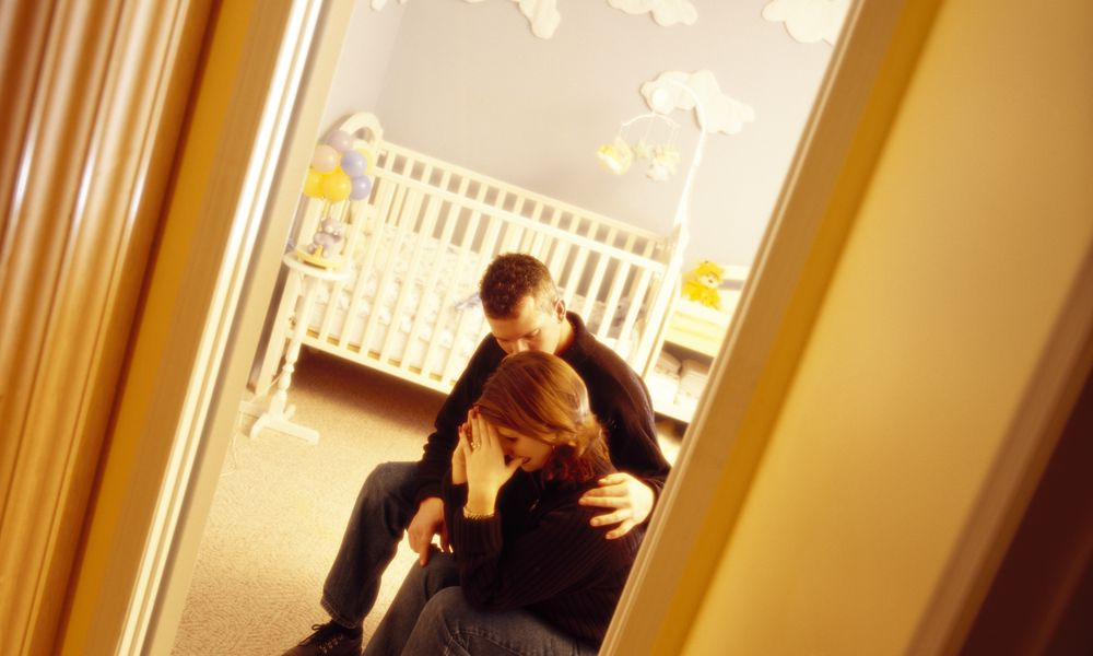 A couple in a baby room