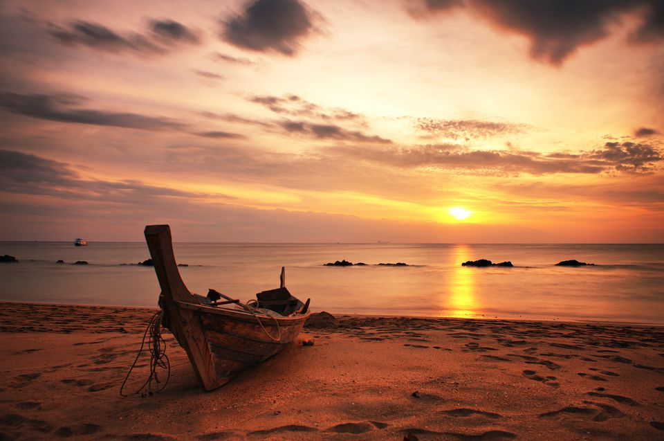 Sunset and a boat on Koh Lanta, Thailand