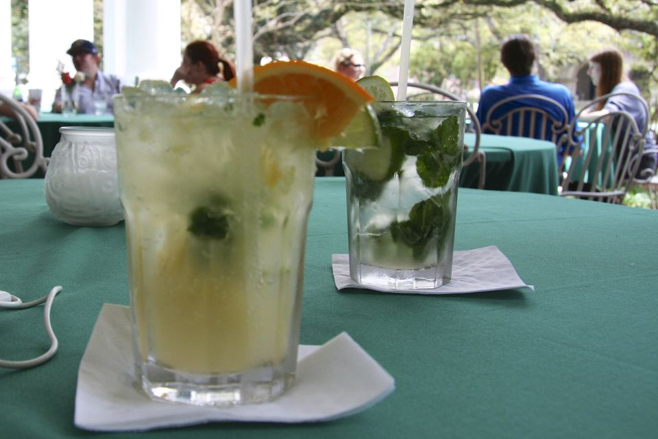 Have a refreshing cocktail on the porch at the iconic Columns Hotel.