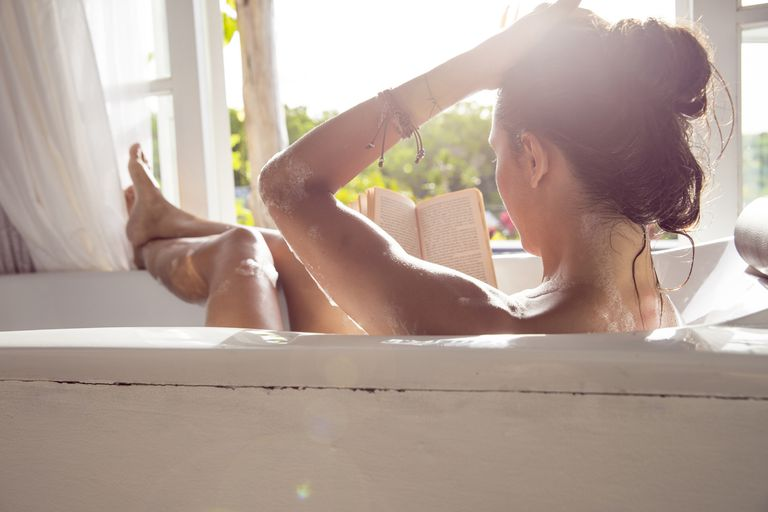 Woman reading in the tub