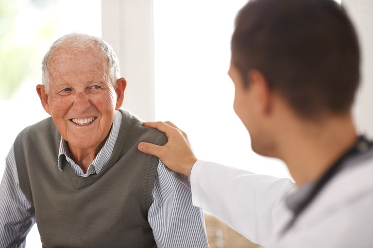doctor talking with elderly male patient about osteopenia