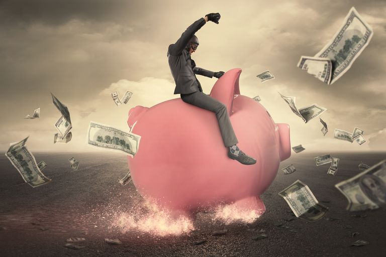 Man Riding Piggy Bank Rocket