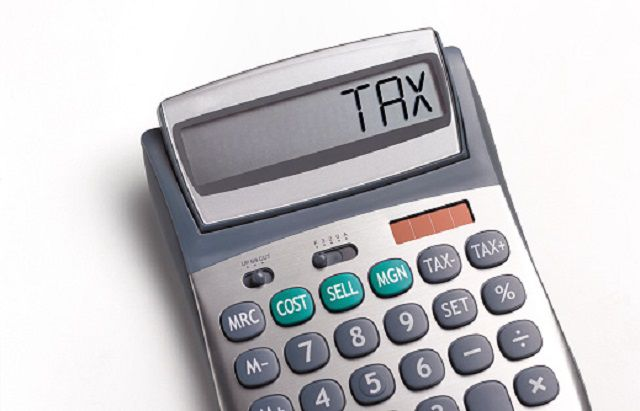 Tax written on a calculator