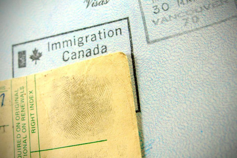 Fingerprints on an American stamped passport visa page.