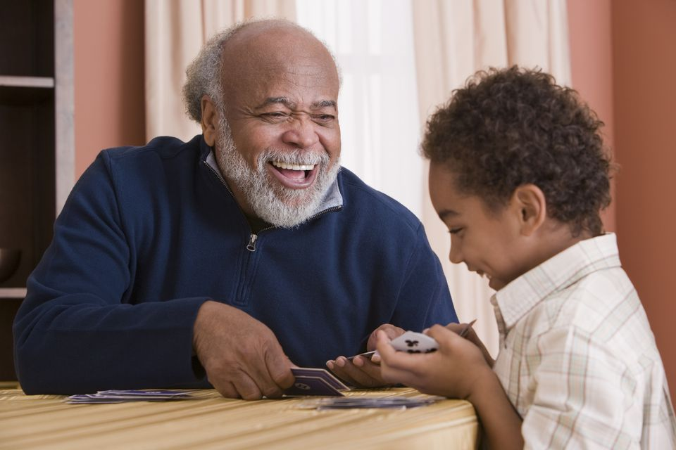 Grandfather and grandson playing cards