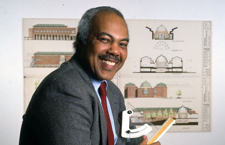 African-American Architect J. Max Bond, smiling, middle-aged, dark mustache, suit and tie