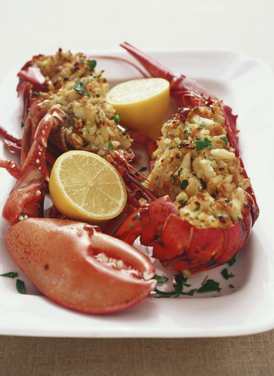 Baked Stuffed Lobster with Crab Meat and Bread Crumb Stuffing Garnished with Lemon Halves