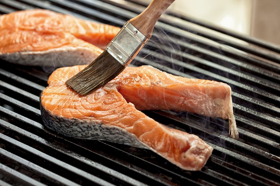 Raw salmon on the grill