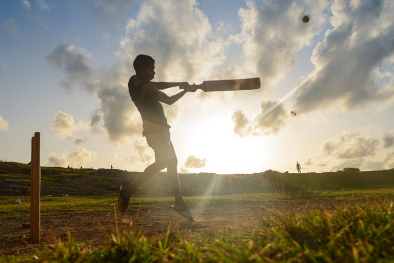 Silhouette of a man playing cricket, Galle, Sri Lanka