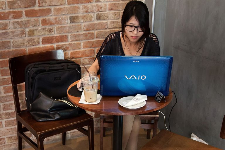 Woman working on a laptop computer.