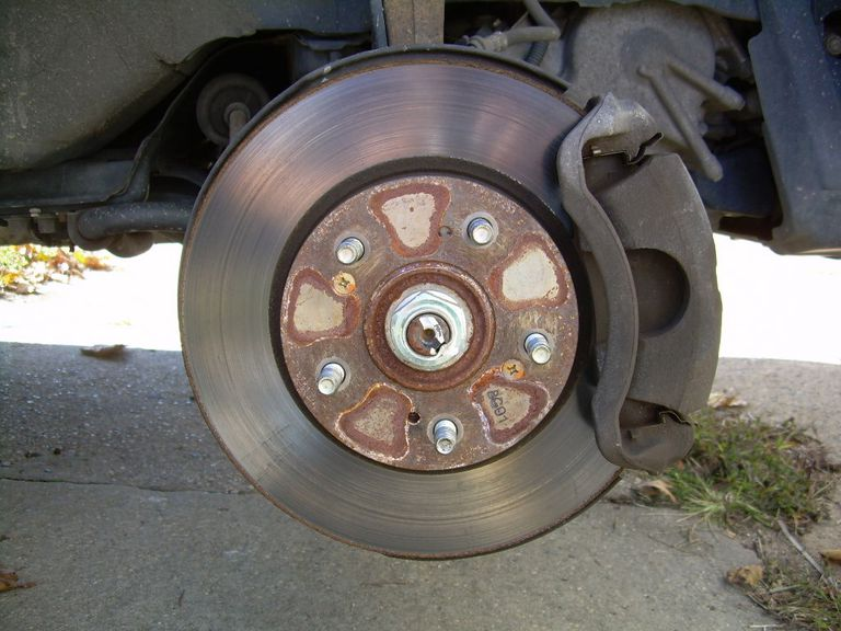 Removing the wheel to change your brake pads.