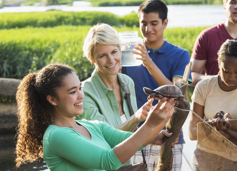 Volunteer teaching kids about nature