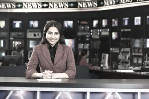 Newswoman sitting at desk