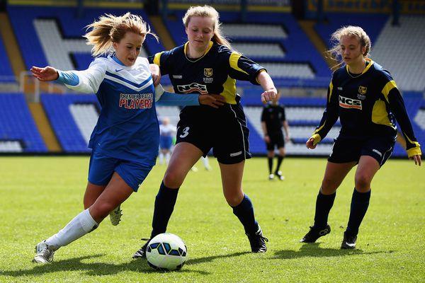 A girls soccer game.