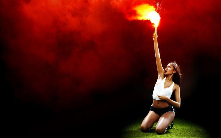 The red of this flare comes from the emission spectrum of strontium salts.