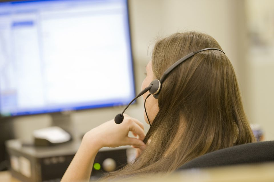 Woman in call center on phone