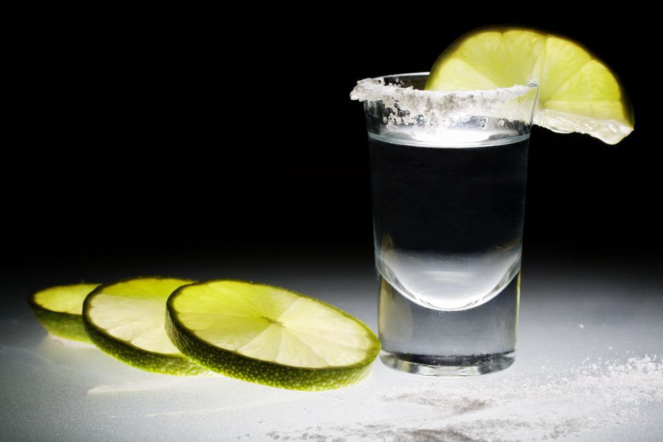 Shot of blanco tequila with lime and salt